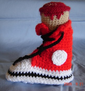 "Found in the Dabbled flickr Group: ""crochet shoe with severed leg"" by the cramped hand"