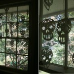 These nifty window treatments are the skull shape, cut out of pages from old books.  Light and airy...