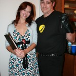 Penny and Captain Hammer (note the shrapnel)