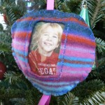 Upcycled craft: Make a felted sweater 'picture frame' ornament.  We did these for grandparents last year.