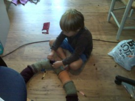 the boy, patching his stuffed snake