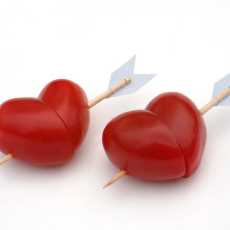 cherry tomatoes shaped like cupid hearts with arrows